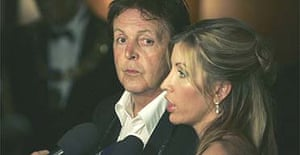 Sir Paul McCartney and his wife Lady Heather Mills McCartney appear at a charity gala in May 2005