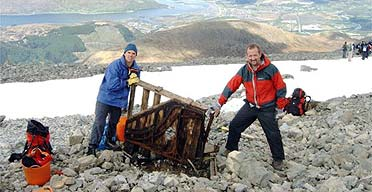 Paul Nelson and Andrew Hunter with the piano they found on top Ben Nevis