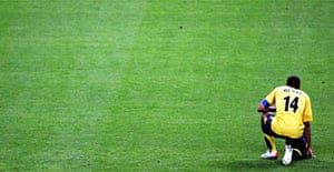 Thierry Henry sits alone in the Stade de France after Arsenal's 2-1 defeat by Barcelona in the European Champions League final last night. Photograph: Martin Rose/Getty