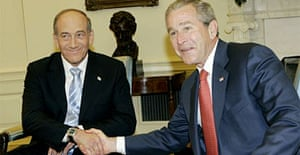 George Bush, right, meets with the Israeli prime minister, Ehud Olmert. Photograph: Pablo Martinez Monsivais/AP