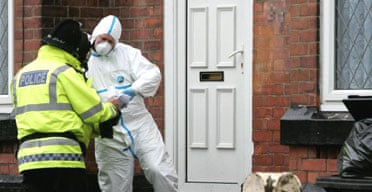 Police outside a house in the Whalley Range area of Manchester after around 500 officers from five forces carried out anti-terror raids at several locations. Photograph: Martin Rickett/PA