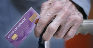 A pensioner with her new pension account card. Photograph: Christopher Furlong/Getty Images