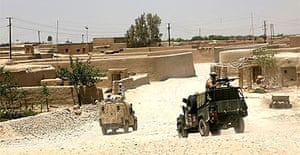 British soldiers transport unexploded ordnance in Afghanistan