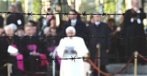 Pope Benedict XVI appears behind barbed wire as he attends a memorial service for victims of the former concentration camps of Auschwitz-Birkenau in Auschwitz, Poland