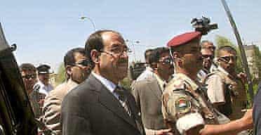 Iraqi soldiers salute Prime Minister Nuri al-Maliki