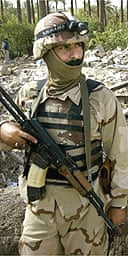 Iraqi soldier guards the remains of the house in which Zarqawi was killed