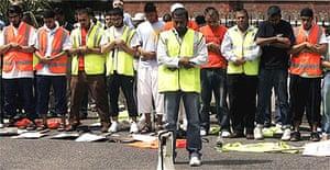 Muslims pray outside the Metropolitan Police HQ