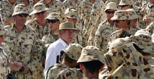 The Australian prime minster, John Howard, with his country's troops in Baghdad. Photograph: Andrew Taylor/Reuters