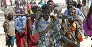 Militiamen from the Islamic Courts Union at El Maan port, just north of Mogadishu. Photograph: Karel Prinsloo/AP