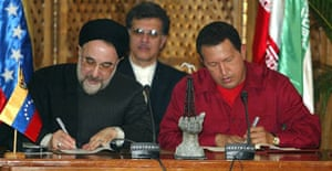 The former Iranian president Mohammad Khatami (l) and his Venezuelan counterpart, Hugo Chávez sign agreements in Caracas in 2005. Photogarph: Andrew Alvarez/AFP/Getty Images