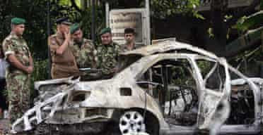 The wreckage of the car in which Major General Parami Kulatunga, the third-highest-ranking officer in Sri Lanka's military, was killed when his vehicle was attacked by a suicide bomber. Photograph: Gemunu Amarasinghe/AP