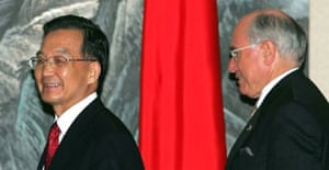 The Australian prime minister, John Howard (r), and the Chinese premier, Wen Jiabao, at press conference in Guangdong province. Photograph: Greg Baker/AP