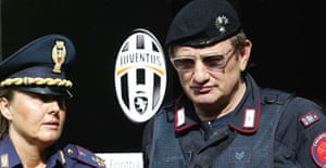 Italian police on duty outside a Juventus's offices. Photograph: Paco Serinelli/AFP/Getty Images