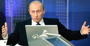The Russian president, Vladimir Putin, answers questions during an online conference in Moscow ahead of next week's G8 summit. Photograph: Dmitry Astakhov/AP