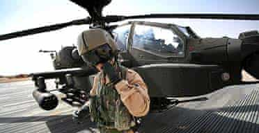 The pilot of an AH-64 Apache helicopter at the British base Camp Bastion in Helmand province