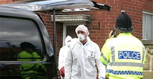 Forensics officers at Benwell Grove, in Newcastle upon Tyne's west end, where four family members were shot dead