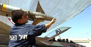 An Israeli airforce mechanic readies a jet fighter