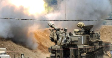Israeli troops fire artillery shells into southern Lebanon. Photograph: Avihu Shapira/AFP/Getty Images