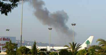 Smoke rises from Beirut international airport after being hit by Israeli planes
