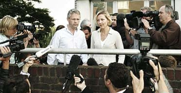 David Bermingham, one of the Natwest Three, and his wife Emma speak to the media as they arrive at a police station in Croydon