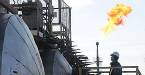 A worker at an oil field controlled by Rosneft