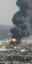 Flames and thick smoke rise from fuel tanks hit in an Israeli air strike at Beirut airport. Photograph: Rami Haidar/AFP/Getty Images