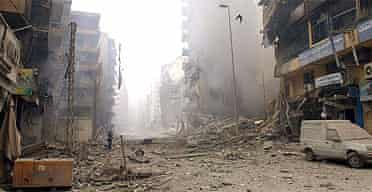 Smoke rises from demolished buildings in the Hizbullah stronghold of southern Beirut after Israeli air strikes on Sunday 16 July 2006
