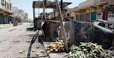 A destroyed market remains empty after being raided by armed gunmen in Mahmoudiya, just south of Baghdad