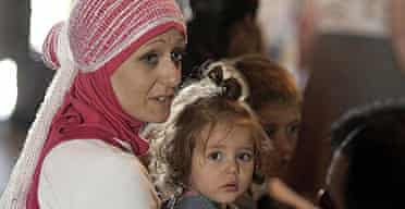 Briton Samatha Bradley Hojeij, 37, and her 16-month-old daughter Aiya arrive at a reception centre in Limassol, Cyprus after being evacuated by HMS Gloucester from Lebanon