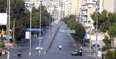 Streets are empty in many parts of Beirut, but some are trying to carry on as normal.