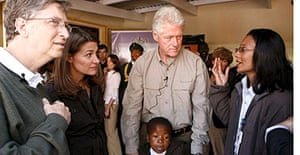 Bill Gates, his wife Melinda and Bill Clinton visit patients and staff at a HIV / Aids facility in Maseru, Lesotho, South Africa