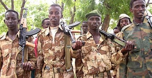 Uniformed militia men parade in Somalia's capital, Mogadishu