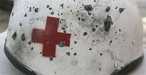 The helmet of a Red Cross volunteer injured when Israeli rockets hit his ambulance in Tyre