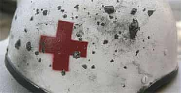 The helmet of a Red Cross volunteer injured when Israeli rockets hit his ambulance in Tyre