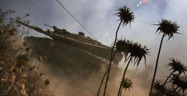 An Israeli tank crosses into southern Lebanon.