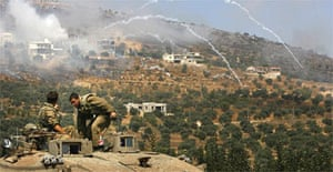 Israeli soldiers carry out their operations near the Lebanese border. Photograph: David Guttenfelder/AP