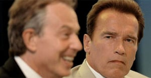 Arnold Schwarzenegger looks on as Tony Blair talks during a meeting in California. Photograph: Stefan Rousseau/PA