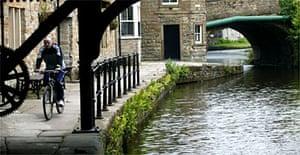 The Leeds-Liverpool canal slicing through East Lancashire. Photograph: Don McPhee/Guardian