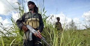 Sri Lankan soldiers stand guard in a rice field near Trincomalee.