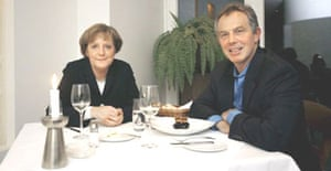 German Chancellor Angela Merkel with Tony Blair at a restaurant in Berlin preceding talks in Germany.