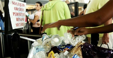Passengers dump water bottles and other liquid containers near the security checkpoint at Dulles airport in Virginia. Photograph: Kevin Wolf/AP