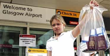 Holly Kennedy,12, holds a plastic bag containing her passport at Glasgow airport. Photograph: Andrew Milligan/PA