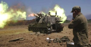An Israeli artillery unit fires a shell towards Lebanon from its position near the Israeli-Lebanese border.
