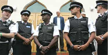 Police officers outside the Masjid-E-Umer mosque in Walthamstow