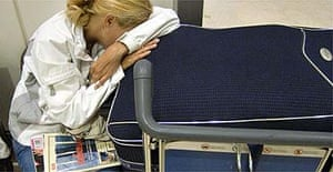 A passenger sleeps at Heathrow airport. Photograph: Leon Neal/AFP/Getty