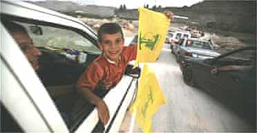 Lebanese boy waves a Hizbullah flag
