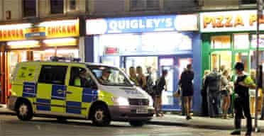 Police on patrol outside a rank of late-night take-away restaurants in Bristol city centre. Photograph: Matt Cardy/Getty