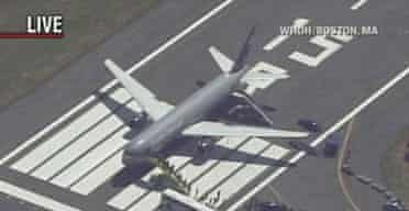 A TV image of passengers exiting United flight 923 at Logan airport, Boston. The London to Washington flight was diverted after a passenger pulled out a screw driver, matches, Vaseline and a note referencing al-Qaida, according to airport authorities.