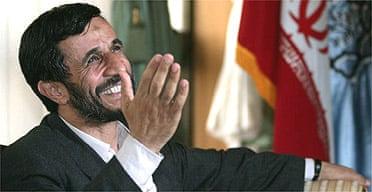 Mahmoud Ahmadinejad waves from his office in Tehran