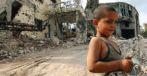 A child plays in the streets of Aitta Shaaba, a village riddled with cluster bombs